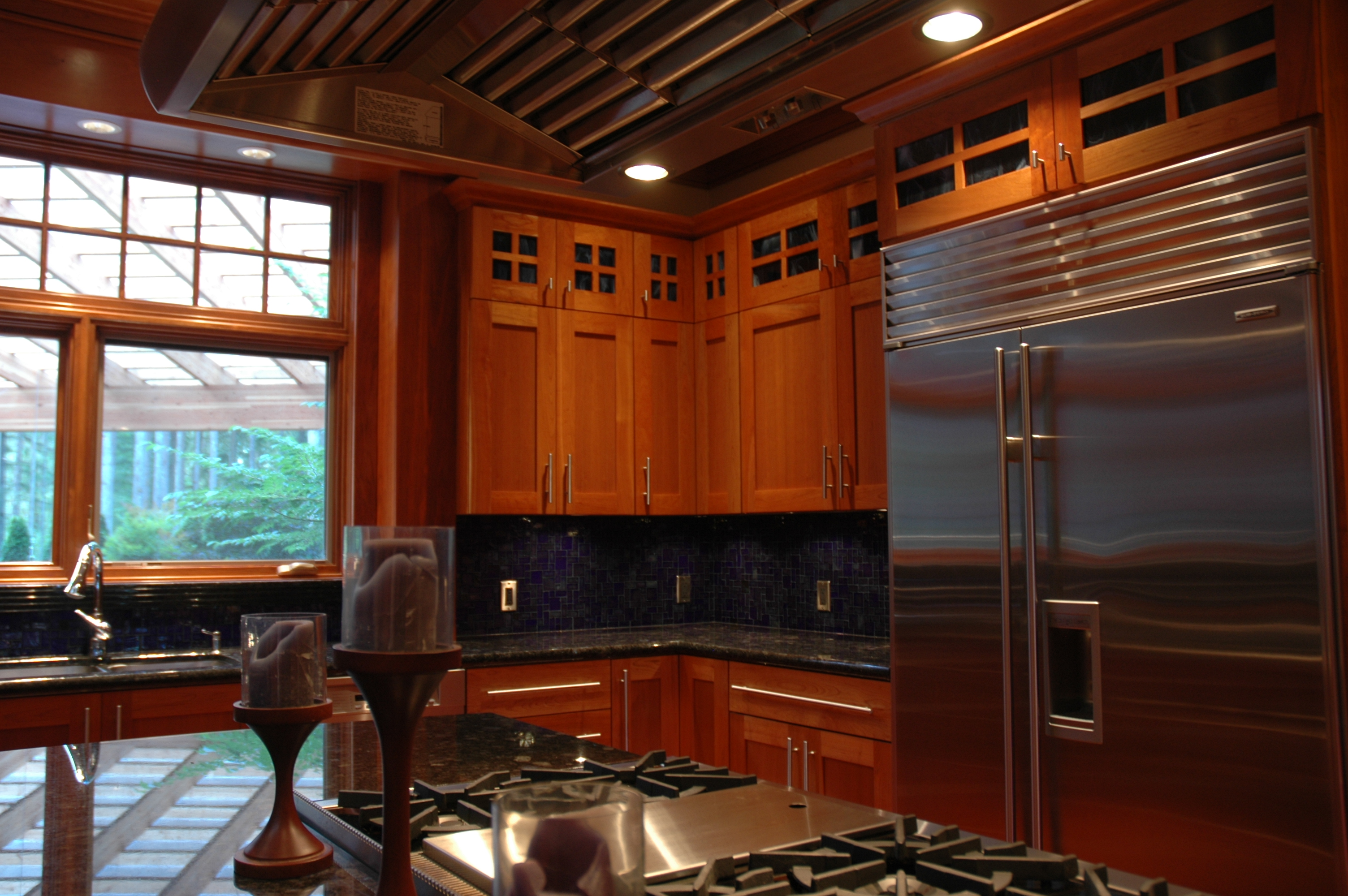 Kitchen View Cabinets with stain glass trim